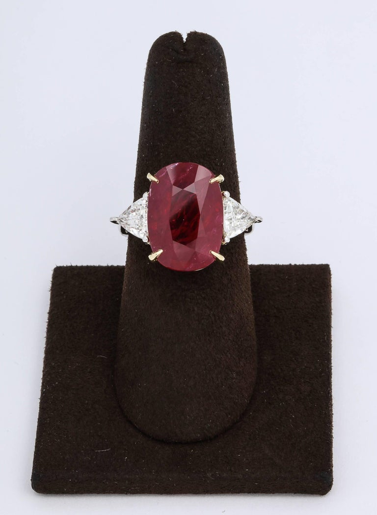 A stunning center Ruby rich in color, a fantastic ring!  A beautiful elongated cushion cut red ruby.  Set with 1.29 carats of trillion cut diamonds.  The center Ruby measures 16.51 x 11.57 mm -- its a Fabulous shape!  Platinum and 18k yellow