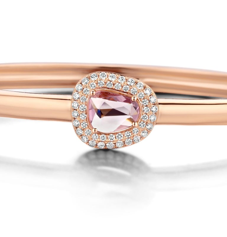 """One of a kind cluster """"Didi"""" bangle in 18K rose gold 23,6g set with the finest diamonds in brilliant cut 0,42Ct (VS/F quality), a natural pink sapphire 1,16Ct in double rose cut.   Because every sapphire has his own irregular shape and color, every"""