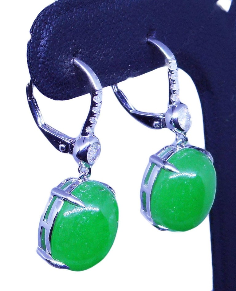 A PAIR OF  JADE AND DIAMOND DROP EARRINGS by Cartmer Jewellery  2 Oval Jade 11.61 Carat 10 Diamonds totalling 0.24 Carat 18 Carat White Gold  FREE express postage usually 3-4 days Sydney to New York  FREE international insurance by Cartmer
