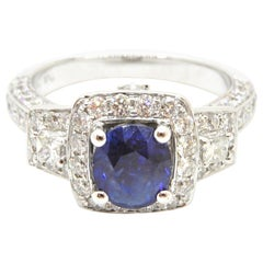 1.17 Carat Oval Blue Natural Sapphire and Diamond Trilogy Halo Engagement Ring