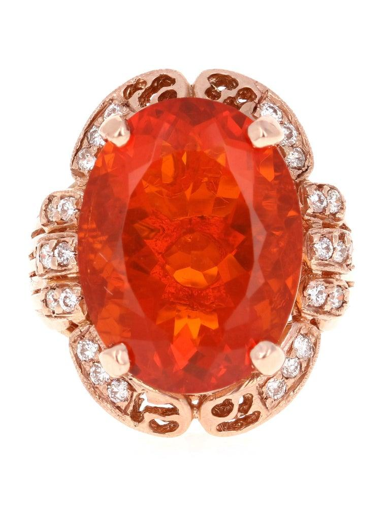 Bold, Beautiful and Bright Orange Fire Opal Cocktail Ring!  This ring has a stunning 11.29 Carat Oval Cut Fire Opal in the center of the ring and is surrounded by 26 Round Brilliant Cut Diamonds that weigh a total of 0.42 Carats. The total carat