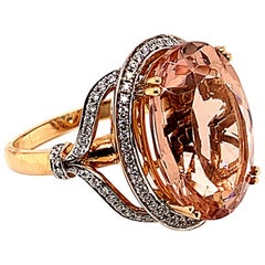 11.84 Carat Oval Shaped Morganite Ring in 18 Karat Rose Gold with Diamonds