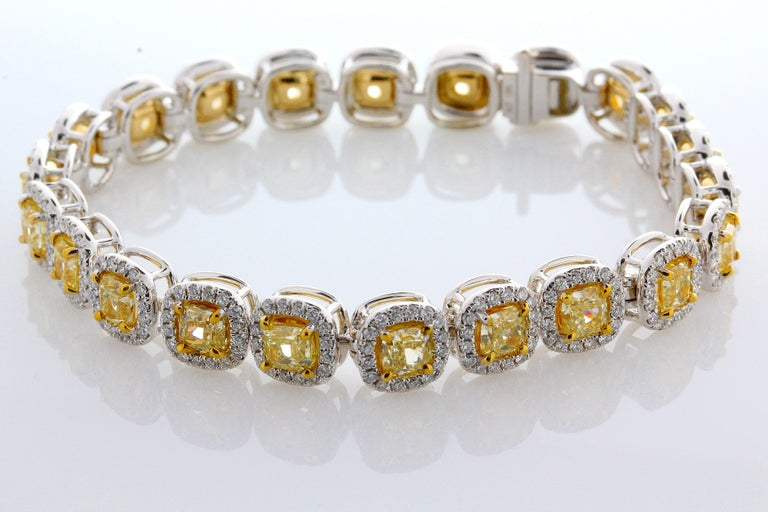 Video available upon request.  11.88 Carat Cushion Cut, perfectly matched Natural Fancy Yellow, VS2+ Clarity Diamond Tennis Bracelet. Total Carat Weight on the Bracelet is 14.58. This contemporary mounting is formed from 18 Karat White and 18K