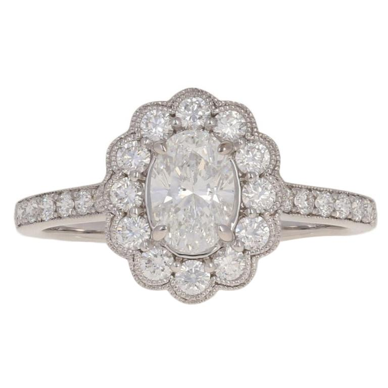 1.19 Carat Oval Cut Diamond Halo Engagement Ring, 18 Karat White Gold Floral GIA For Sale