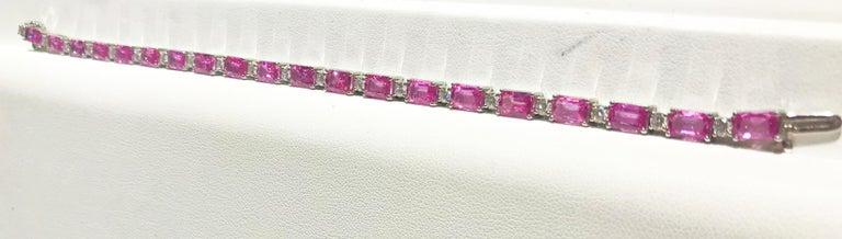20 Emerald Cut Pink Sapphires =  11.93 carats total weight  20 Round Brilliant Cut Diamonds =  1.45 carats total weight  Set in 14 karat white gold.