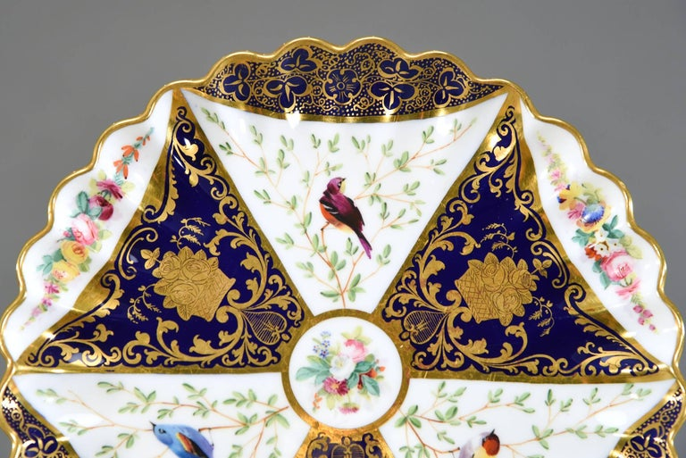 This set of 12 lovely aesthetic movement Spode Copeland's dessert plates feature an eye-catching geometric design decorated with cobalt blue, raised gold and best of all, hand-painted birds. The borders are further embellished with hand-painted