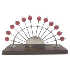 12 Art Deco Cocktail Picks with Cherry Red Tops in a Chrome Fan-Form Stand