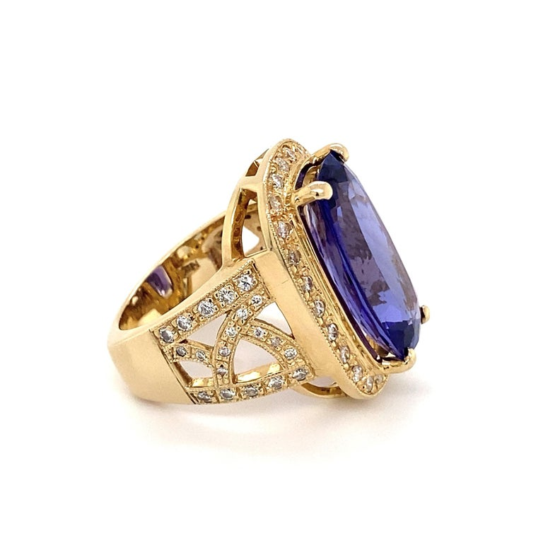 """Simply Beautiful! Cushion Pink Tanzanite and Diamond Gold Ring. Center securely set with a Cushion Tanzanite weighing 12 Carat. Amazing color! Surrounded by Hand set Diamonds, approx. 1.50tcw. Hand crafted 14K Yellow Gold mounting. Dimensions: 1.10"""""""