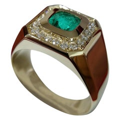 1.2 Carat Emerald and Diamond Gold Engagement Ring