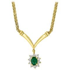 1.2 Carat Oval Shape Emerald & .5 Carat Diamond Necklace in 14 Karat Yellow Gold