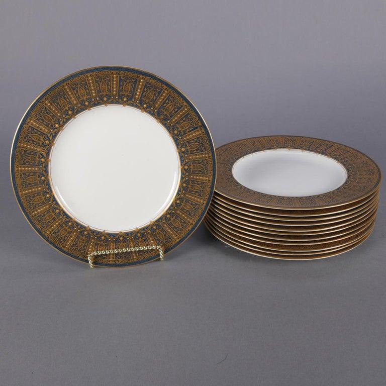 Set of 12 English Royal Worcester for Ovington Bros. Co. fine china porcelain dinner plates feature rims with gilt Moorish design over cobalt blue ground, en verso stamped, circa 1900.  Measures: .75