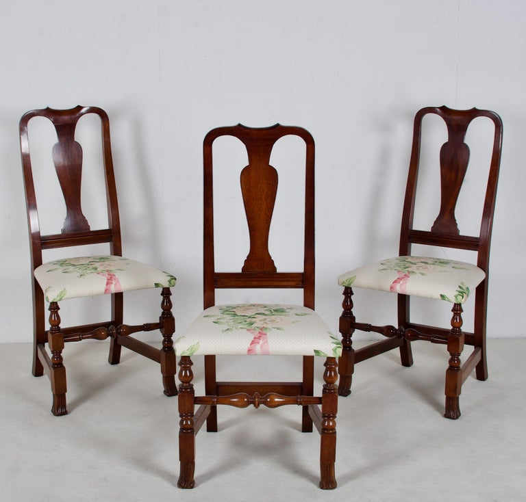 A lovely set of early 20th century American made mahogany dining chairs in the George III style. The chairs have been newly re-upholstered with a Sister Parish style unglazed chintz. The chairs are generous in the seat, and sit quite well.