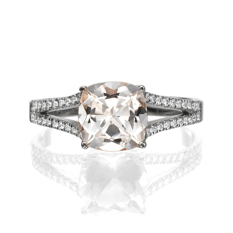 Unique split shank setting ring with beautiful morganite center stone and diamond side stones. Center stone is of 1 carat, natural, cushion shape, peach/pink color morganite and it is surrounded with 26 natural diamonds.   Main Stone Name: