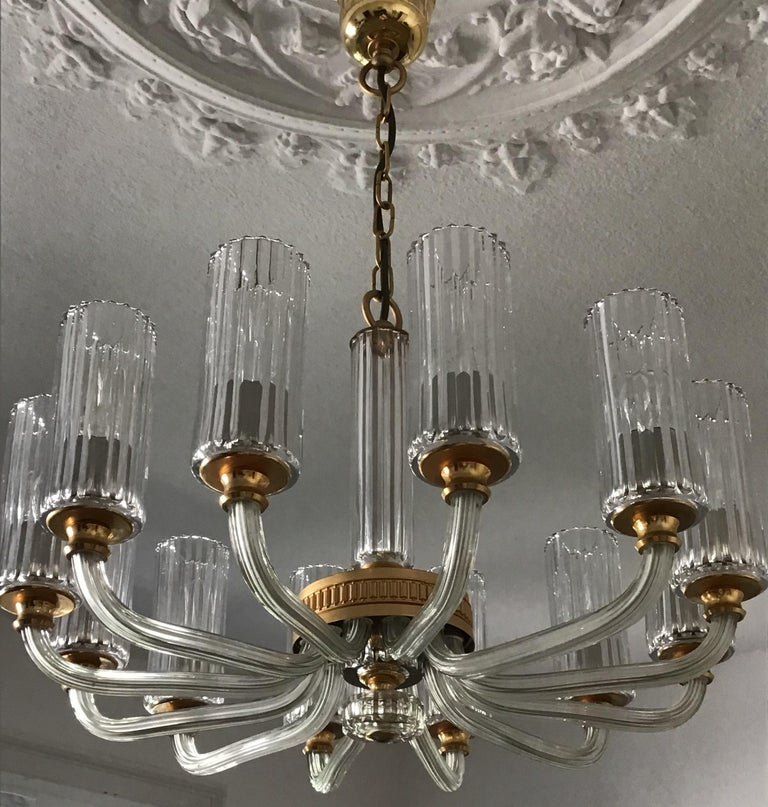 Very elegant and high quality 12- arm crystal glass chandelier Italy, circa 1980s. The condition is excellent.