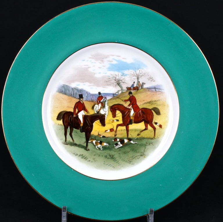 These 12 fox hunt cabinet or dinner plates are from Minton, Stoke-on-Trent, England. Each green-bordered plate depicts a unique English fox hunting scene. Painted by famous Minton artist James Edwin Dean (1880-1935), who specialized in fish, game,