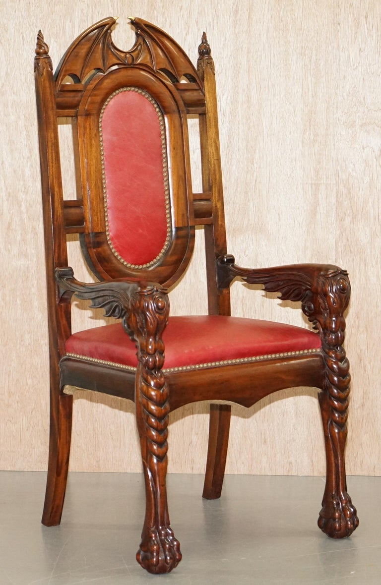 We are delighted to offer for sale this one of a kind suite of 12 original Neil Busby solid mahogany dining chairs with 22ct gold detailing RRP £36,000