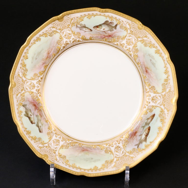 Porcelain 12 Royal Doulton Hand Painted and Heavily Gilded Fish Plates For Sale