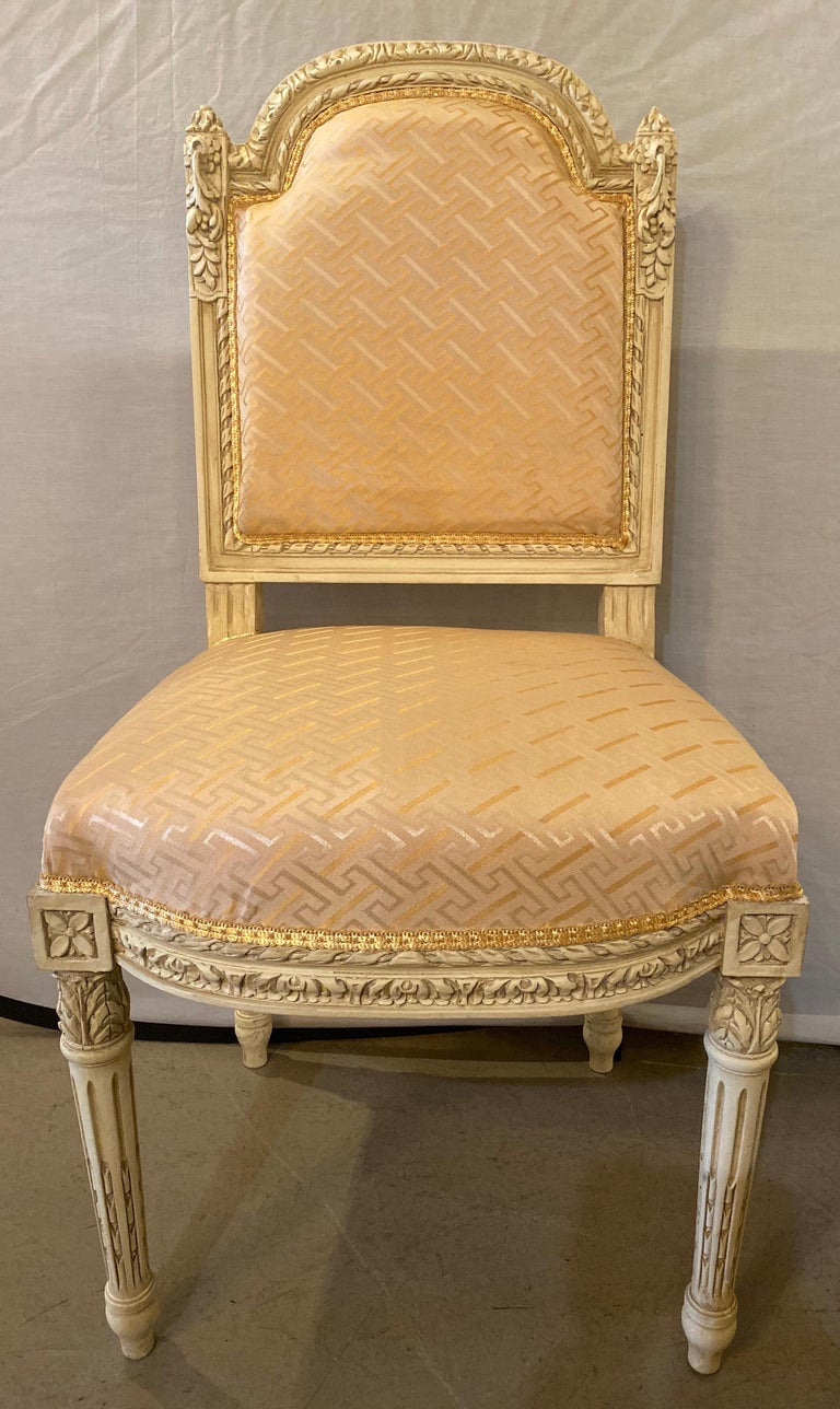 12 Swedish Louis XVI style dining / side chairs painted carved frames in a salmon satin new fabric This stunning set of 12 dining chairs have been fully refinished and each are done in a fine new fabric. Each having a tapering carved group of legs