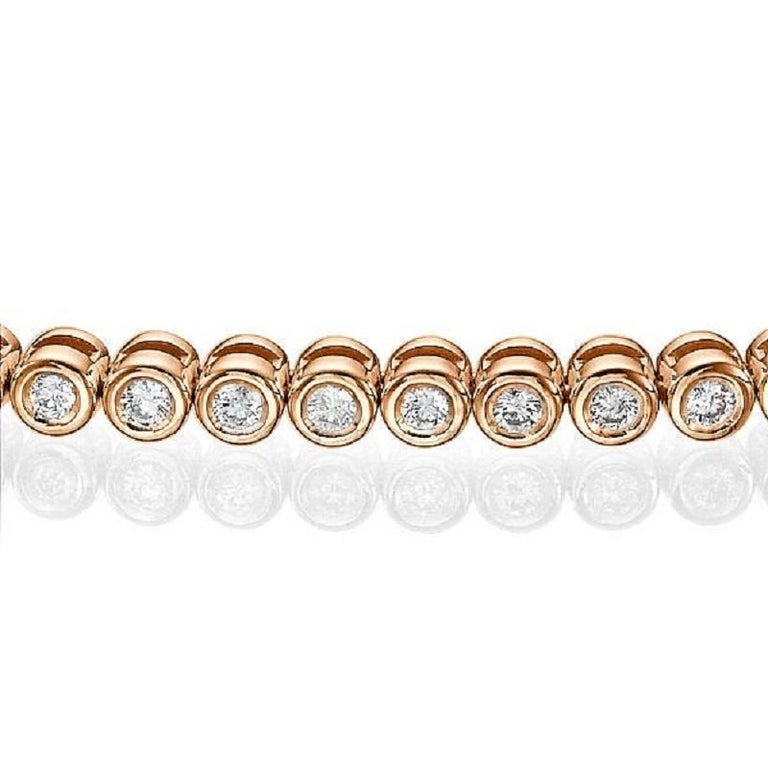 A classic Diamond bracelet made of 14K Rose Gold set with 60 Diamonds. The total carat weight of this beautiful Diamond bracelet is 1.20 carat, D-F color and VS clarity natural diamonds.   Usually made in 7 inch but can also be custom made to any