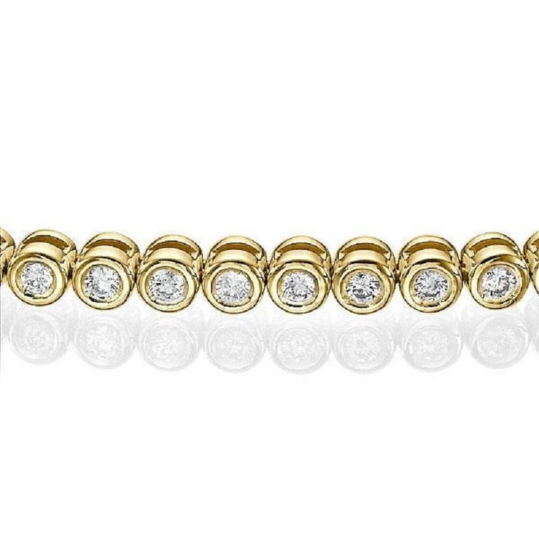 A classic Diamond bracelet made of 14K Yellow Gold set with 60 Diamonds.The total carat weight of this beautiful Diamond bracelet is 1.20 carat, D-F color and VS clarity.    Metal Type:  This bracelet can be made in yellow gold, white gold or rose