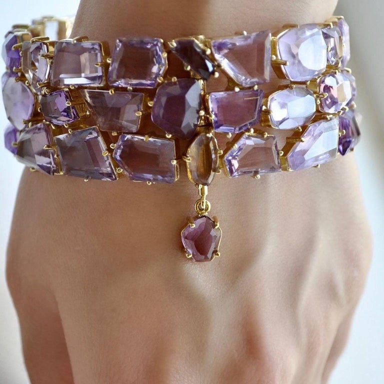 This bracelet belongs to our High Jewelry Collection. It is manufactured from yellow gold with fancy cut amethyst.  It is 100% hand crafted one of a kind cuff bracelet that instantly attracts the attention.  All amethysts are with fancy cut and this