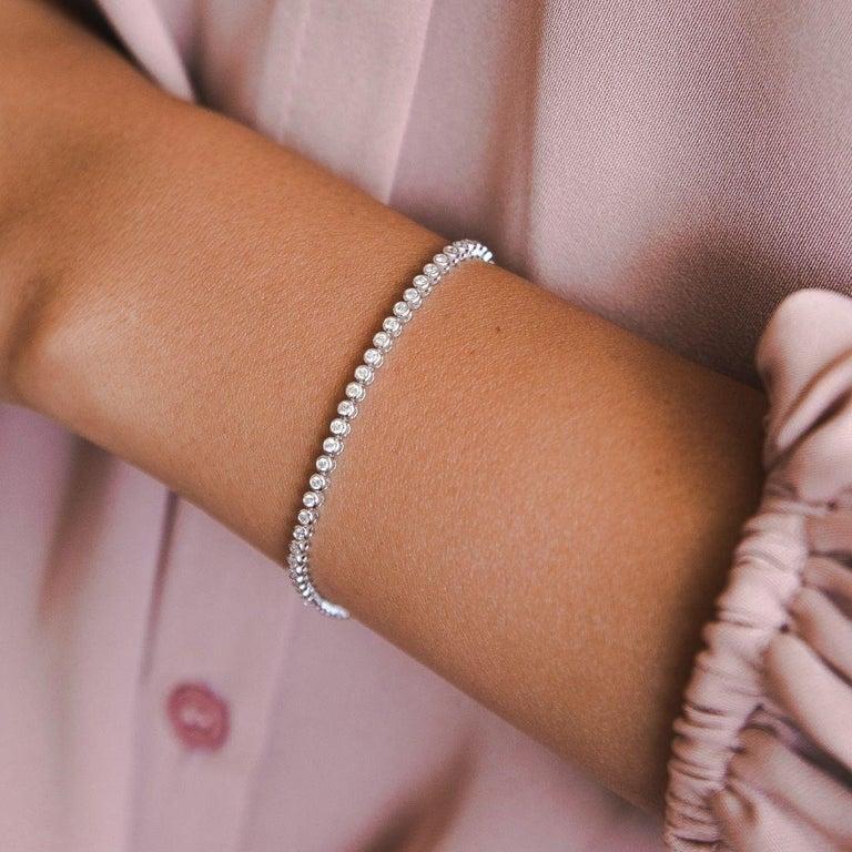 1.20 Carat Diamonds Tennis Bracelet in 14 Karat White Gold - Shlomit Rogel  Glamorous sparkle meets a classic design in this beautifully elegant tennis bracelet. Crafted from 14k solid white gold, the bracelet is bezel set with 66 round genuine