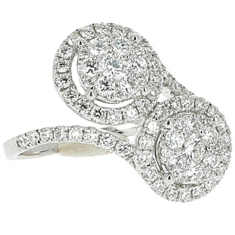 The Forever Ring is a unique jewelry ring set with 78 Round Diamonds weighing 1.20 Carat.  The Diamonds are GVS quality. The Ring is in 18K White. The ring size is 6 ½ US and can be size.