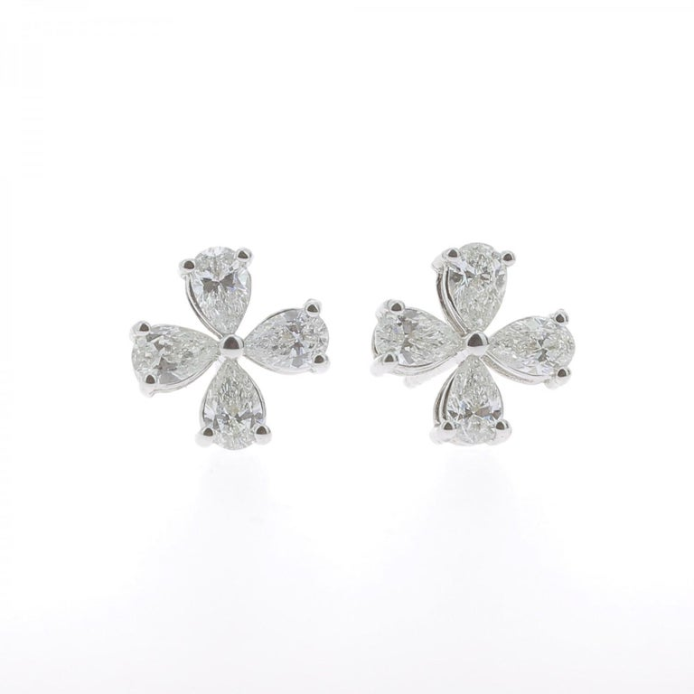The Clover Diamonds Earrings are set with 8 Pear Diamonds weighing 1.20 Carat The Earrings are set with 8 Pear Diamonds with a clover pattern. The Diamonds are GVS quality. The Hoop Earrings is  18K White Gold and weight 2.66 Grams
