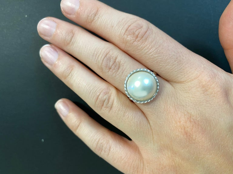A staple for jewelry collectors everywhere, this 1.20 Carat Mother of Pearl Ring is set in a simple 14k White Gold casting. It is Perfect for anyone at any age and is truly a timeless orniment.  Material: 14k White Gold  Center Stone Details: 1.20