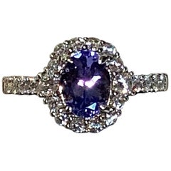 1.20 Carat Oval Tanzanite Diamond Halo Ring
