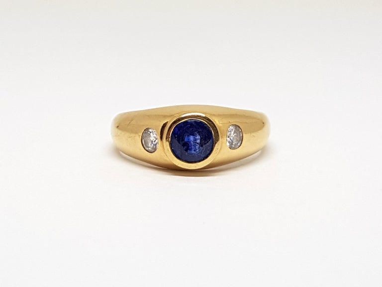 Gold: 18 carat yellow gold Weight: 3.77 gr. Diamonds: 0.30 ct. colour: F clarity: VS Sapphire: 0.90ct. Width: 0.70 cm. Ring size: 51 / 16.25 free adjustment of ring up to size 70 / 22.50mm Shipping: free worldwide insured shipping  All our jewellery