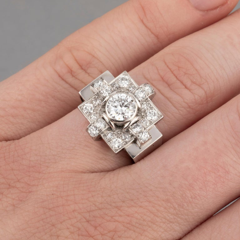 1.20 Carats French Art Deco Ring  Very beautiful ring, made i France circa 1930. Marks for platinum and mark of the maker. The central diamond weight 0.90 Carats estimate. 1.20 Carats total. Size 54 sizeable Dimensions: 1.2*2 cm