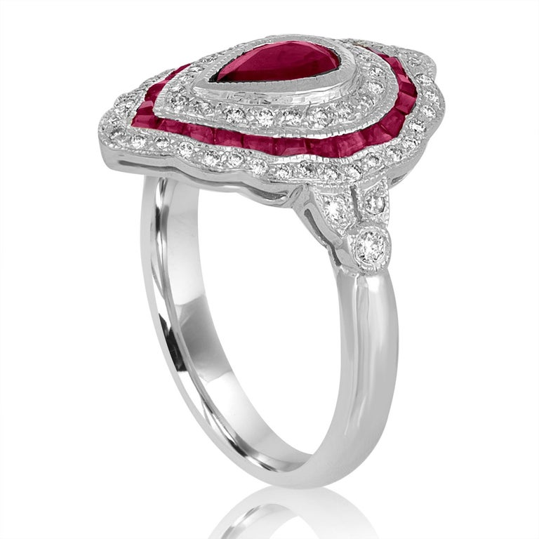 Art Deco Revival Style Ring The ring is 18K White Gold There are 0.40 Carats in Diamonds H SI There are 0.80 Carats in Rubies The ring is a size 6.50, sizable The ring weighs 5.2 grams