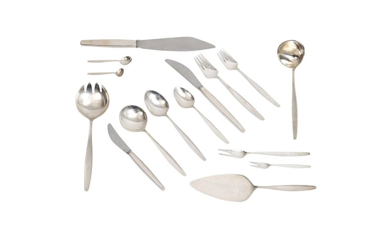 Extensive 120 piece set of sterling silver flatware by Norwegian designer Tias Eckhoff for Georg Jensen. All pieces signed with Jensen's impressed mark. Complete seven piece service for eight or four-piece service for 16 with 14 serving pieces.