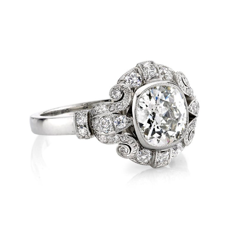 1.20ctw I/VS2 EGL certified vintage Cushion cut diamond set in a handcrafted platinum mounting with 0.25ctw accent stones.     Ring is currently a size 6 and can be sized to fit.