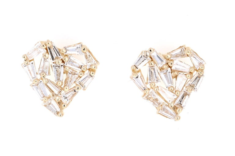 Cute, dainty earrings that make a statement! 1.21 Carat Baguette Cut Diamond 14 Karat Yellow Gold Stud Earrings!  The 28 Baguette Cut Diamonds that weigh  1.21 Carats (Clarity: VS, Color: I)  are carefully set to create a Heart Design giving these a