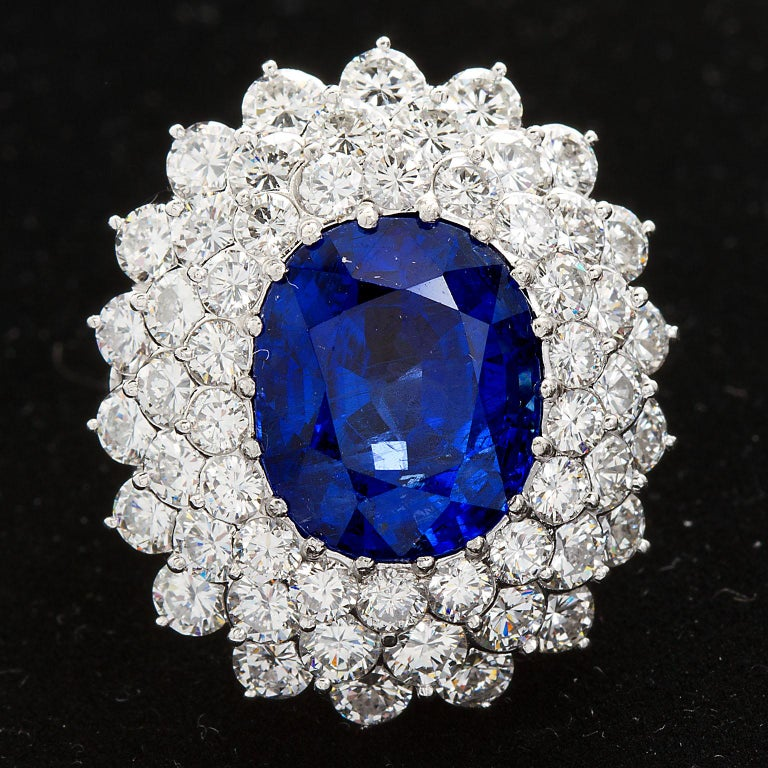 Contemporary 12.10 Carat Burma Unheated Oval Sapphire Diamond Cluster Ring For Sale