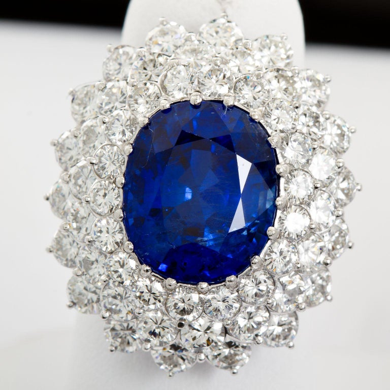 Oval Cut 12.10 Carat Burma Unheated Oval Sapphire Diamond Cluster Ring For Sale