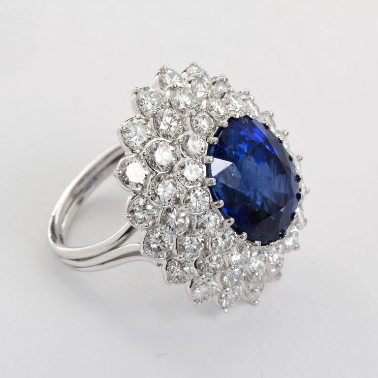 Women's 12.10 Carat Burma Unheated Oval Sapphire Diamond Cluster Ring For Sale