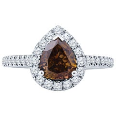 1.21ct Pear Shape Fancy Dark Yellow/Brown Diamond with White Diamond Halo Ring