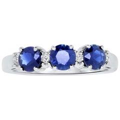 1.22 Carat Three-Stone Blue Sapphire and Diamond Ring