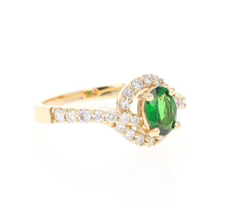 This beautiful ring has a Oval Cut Tsavorite that is 0.62 Carats and 28 Round Cut Diamonds that weigh 0.60 Carats. The total carat weight of the ring is 1.22 Carats.   Tsavorite is a natural stone that belongs to the Garnet family of stones.  The