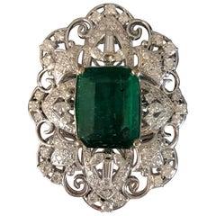 12.24 Carat Emerald and Diamond 18 Karat Gold Cocktail Ring
