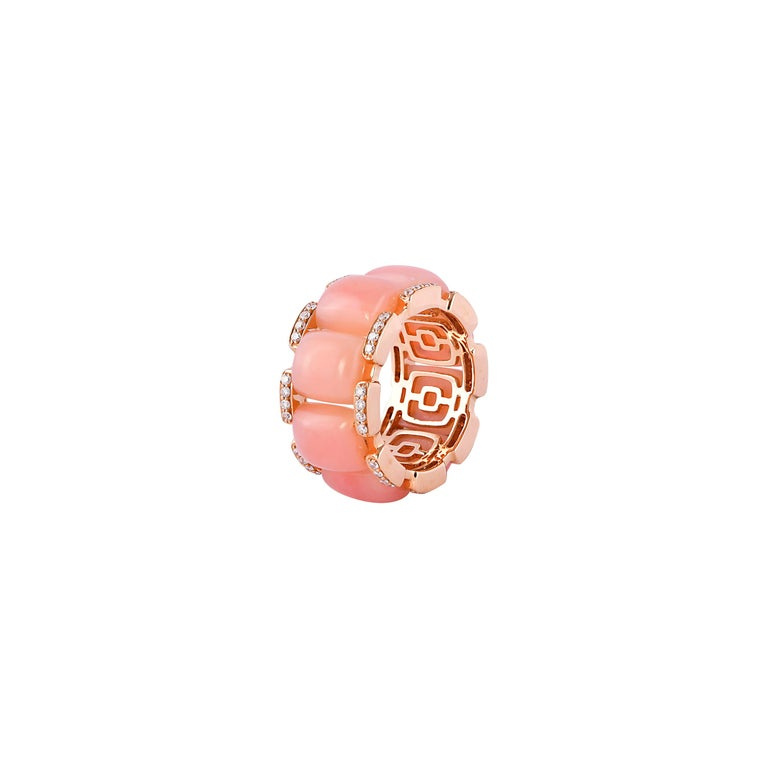 Glamorous Gemstones - Sunita Nahata started off her career as a gemstone trader, and this particular collection reflects her love for multi-coloured semi-precious gemstones. This is a simple yet stylish designer ring featuring pearly pink opals.