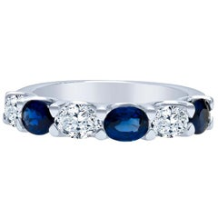 1.23 Carat Total Weight Oval Cut Blue Sapphire and 0.70 Carat Diamond Ring