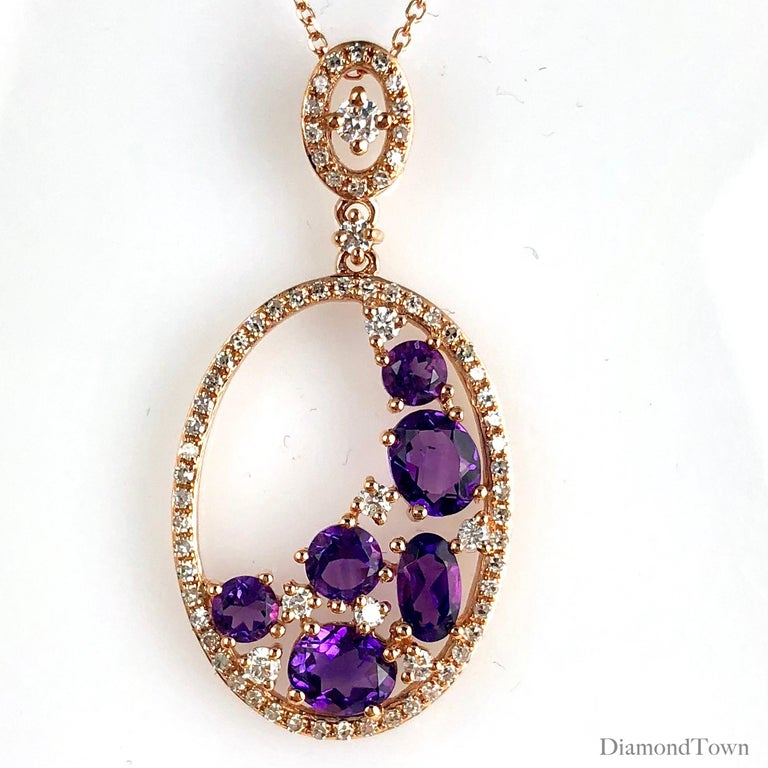 This fashion pendant boasts 1.24 carats beautiful round and oval amethysts, and round diamonds. The pendant's oval shape is formed by a halo of round white diamonds, with additional diamonds in the decorated bail. Total diamond weight 0.36
