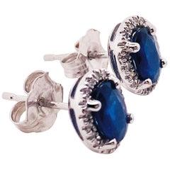 1.25 Carat Blue Sapphire and Diamond Halo Oval Earring Studs in 14 Karat Gold