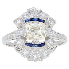 1.25 Carat Diamond and Synthetic Sapphire Art Deco Ring Platinum Vintage Scroll