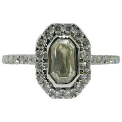 1.25 Carat Emerald Cut Diamond & French Set Diamond Halo Engagement Ring in 18k
