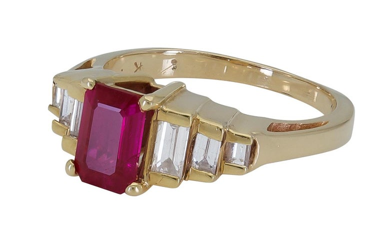 Contemporary 1.25 Carat Emerald Cut Ruby and Diamond Side-Stone Engagement Ring For Sale